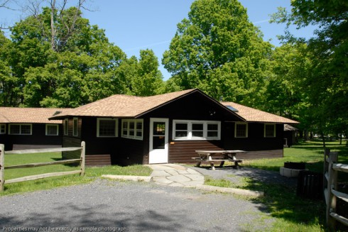 marion living lake york room vacation in george lodge getaways family cabins cottages new