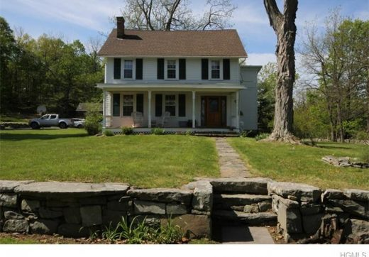 orange county colonial farmhouse with lots of space inside and out