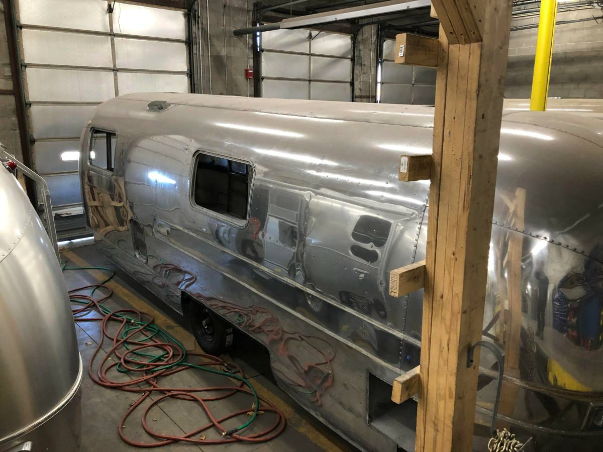 An Airstream trailer for sale in need of your interior design skills...
