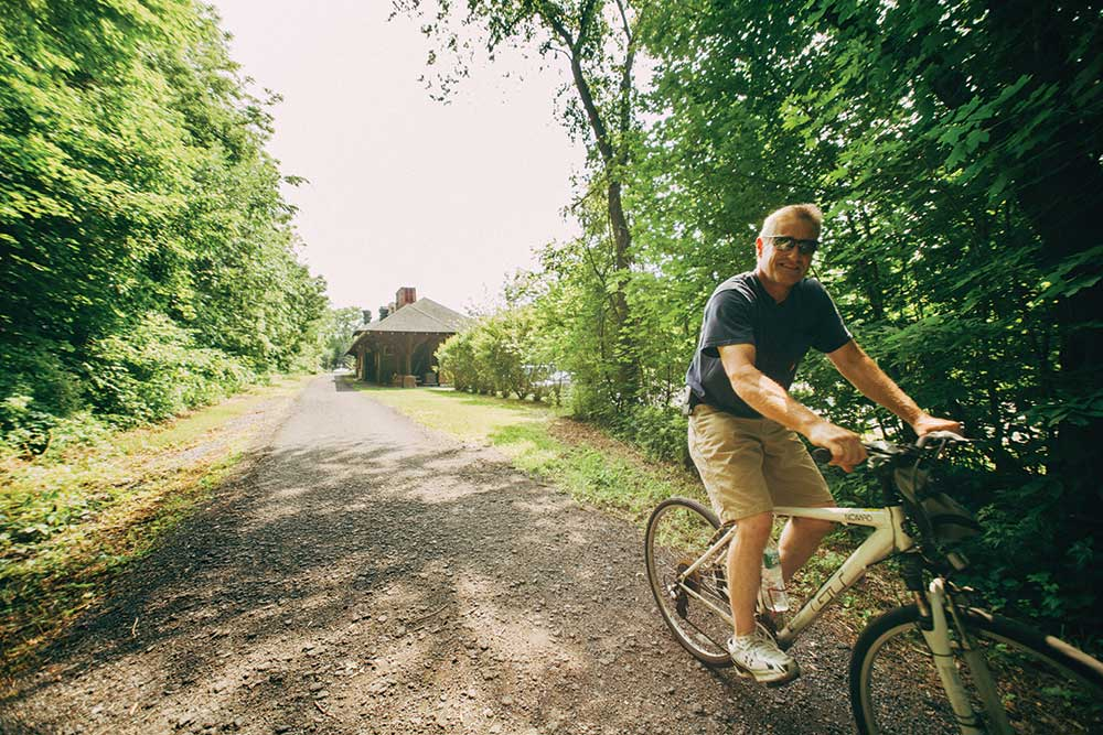 Lloyd-Seeler-from-Kingston-taking-a-bicycle-ride-on-the-rail-trail-in-New-Paltz-2