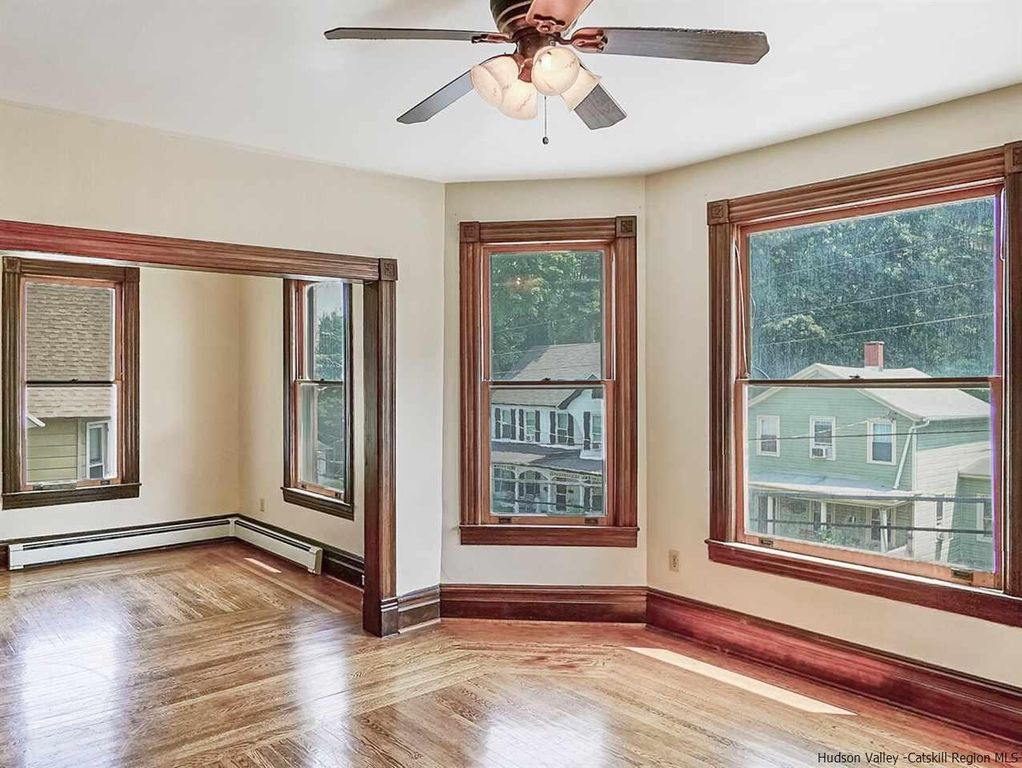 Kingston Victorian Home With Wood Floors Bay Windows And